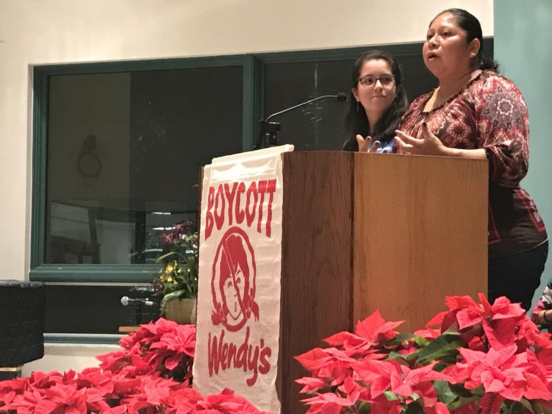 Lupe Gonzalo (right) speaking through translator Patricia Cipollitti (left) about farmworker abuses, as part of a Moral Monday Meetup held monthly at the Unitarian Universalist Church of Greater Naples.