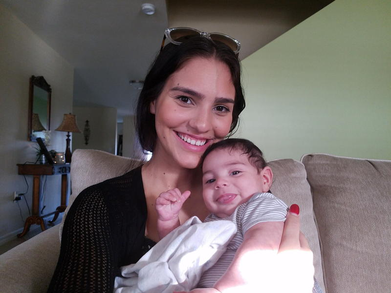 Nicole Reyes with her Florida-born infant son, Nehemiah.