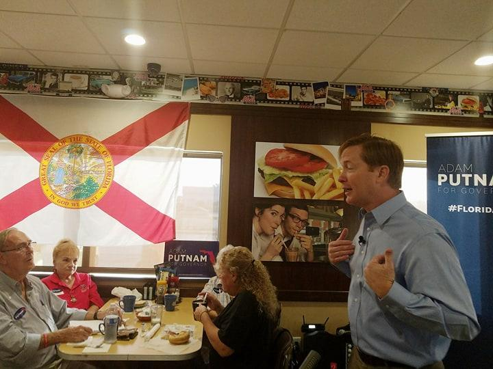 Florida Agriculture Commissioner Adam Putnam talks to supporters at a diner, saying he'll put Florida first as governor.