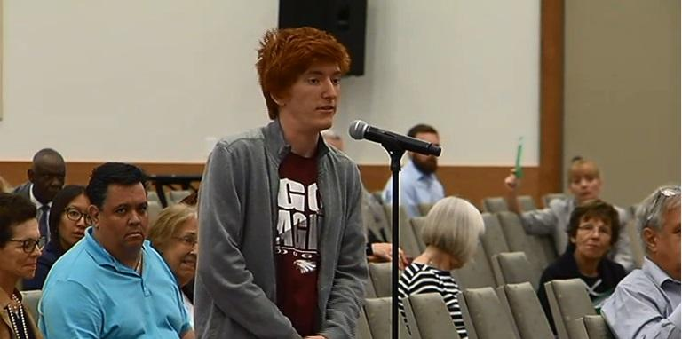 High school senior Ryan Deitch, who survived the shooting in Parkland, tells CRC members to put away their smart phones during public comment.