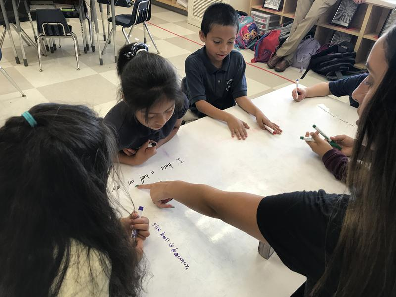 Immokalee High School freshman Emily Deleon tutoring second graders at Pine Crest Elementary after school.