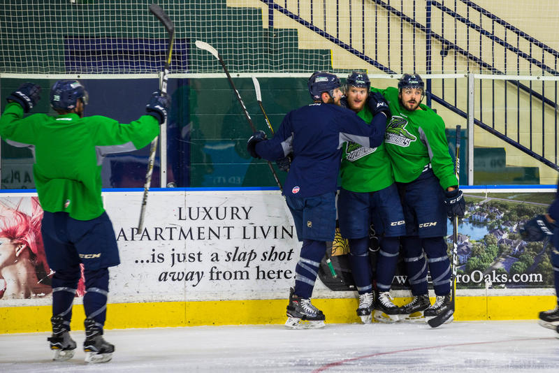 Forward Joe Cox skates toward his embracing teammates at the Everblades practice Friday before Game 7 of the 2018 Kelly Cup Finals.