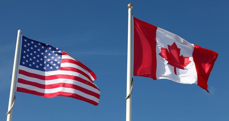 The flags of the U.S. and Canada