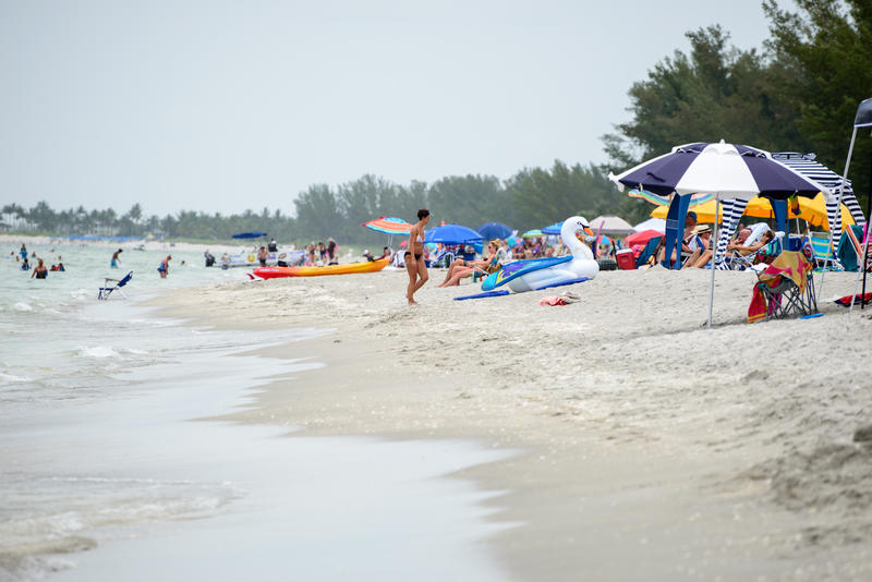 The beach near the Mucky Duck on Captiva Island on Friday, July 6 is still crowded with beachgoers.