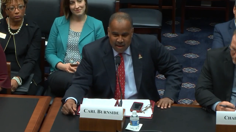 Principal Carl Burnside speaking before members of Congress