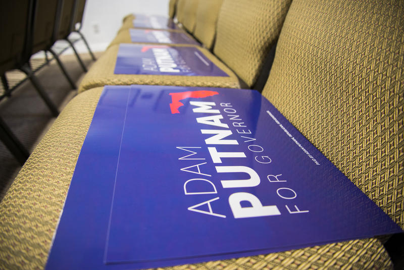Adam Putnam campaign signs await Southwest Florida Republicans on the seats at the Lee County Republican Party debate watch party Aug. 8.