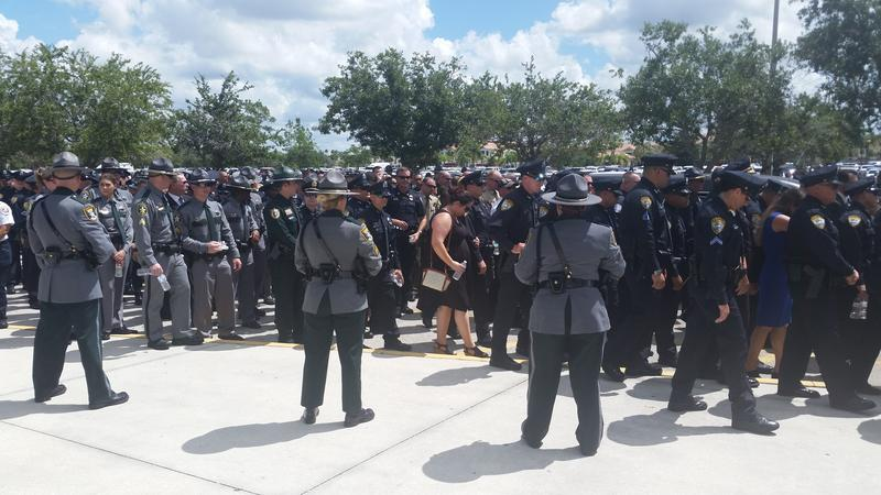 Law Enforcement Officers from across Florida converge outside Germain Arena
