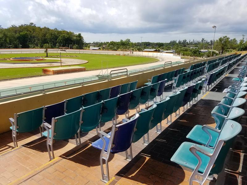 The dog track at Naples-Fort Myers Greyhound Track is completely empty. The venue hosts live races December through May.