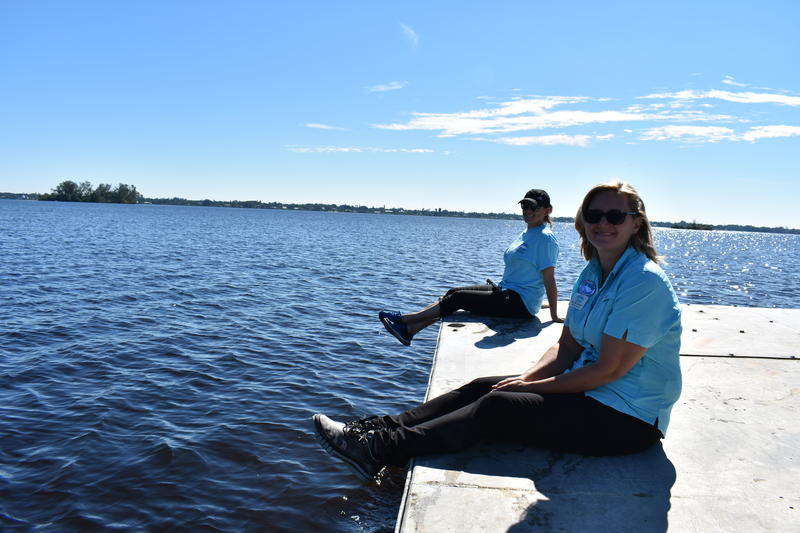 CHNEP Executive Director Jennifer Hecker (far right) and Research and Outreach Specialist Nicole Iadevaia sit on a barge that took them to see a seagrass gardening site on Nov. 21.