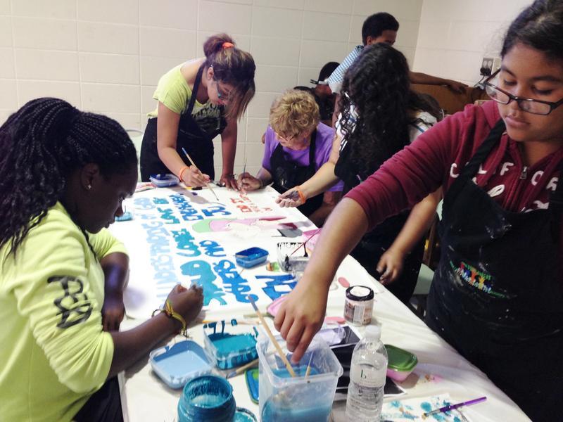 Students Making an ARTREACH Banner