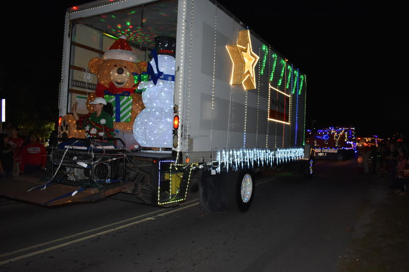 A central part of the festival is a parade where local businesses deck out their trucks and trailers in full Christmas regalia and pass out candy and holiday cheer to people lining the street.