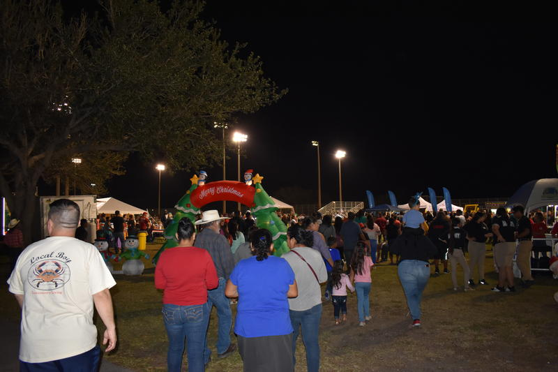 People enter the annual Christmas Around the World festival held at the Immokalee Sports Complex this past Saturday.