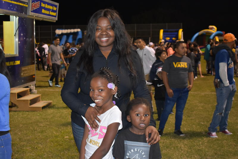 Kristie Pierre poses with her niece and nephew at the 2018 Christmas around the world festival in Immokalee.