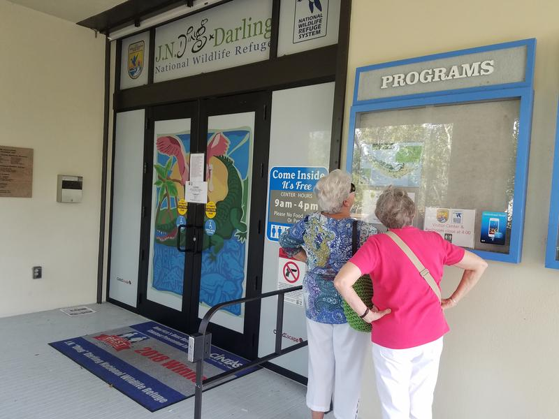 Rose McNelis (left) and her friend, Mary Pat Owen discovered the education center at the Ding Darling National WildlifeRefuge was closed, and look at a map to see what other outdoor activities are available nearby.