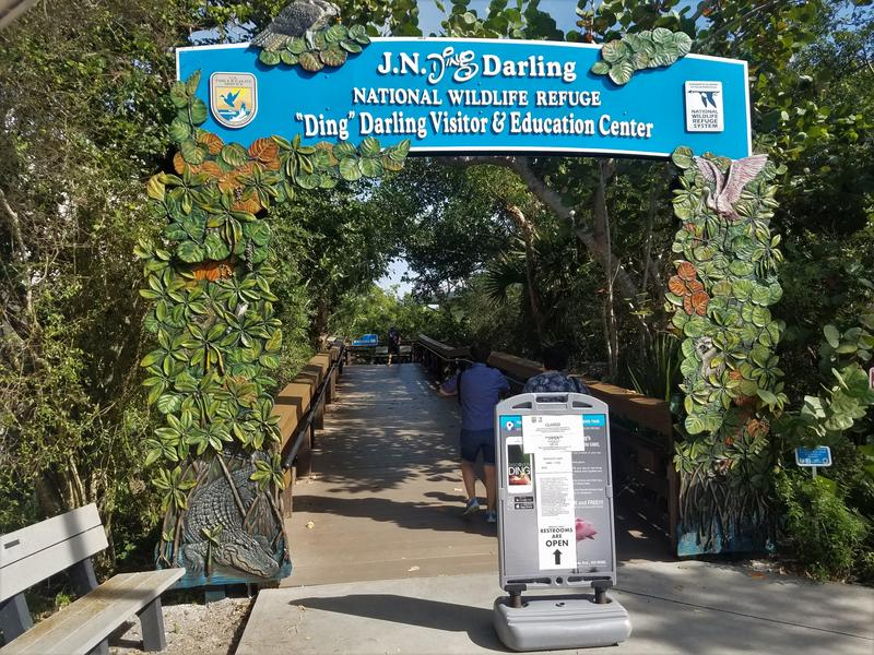 The entrance leading to the J.N. Ding Darling National Wildlife Refuge's visitor and education centers has a sign notifying visitors that the buildings are closed due to the government shutdown.