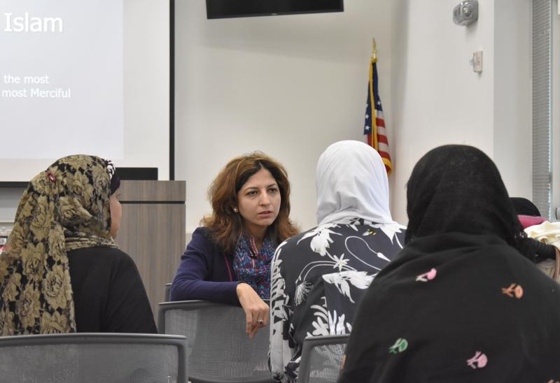 Lubna Alam, the founder of the Muslim Women's Council of Southwest Florida, speaks to participants of Hijab Day before the event starts.