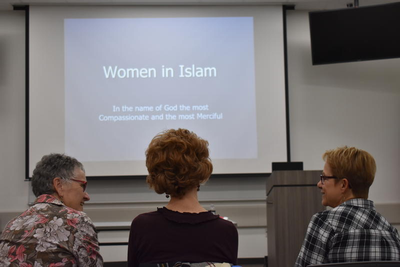 Barb Sheets (left), Laura Ruzicho (center) and Ruth Deyoe are Christians. They sat front row at the  HIjab Day event to learn more about the Muslim religion.