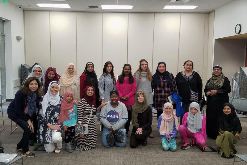 A group of women pose in a meeting room of the Fort Myers Regional Library for the Hijab Day event hosted by the Muslim Women's Council  of Southwest Florida.