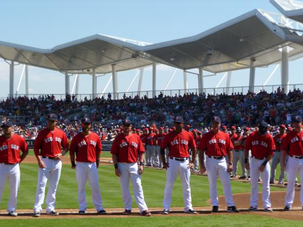 Boston Red Sox and Minnesota Twins players before their inaugural game of the 2014 Spring Training Season