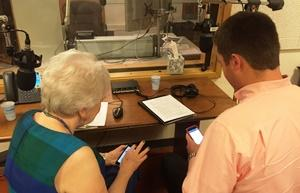 McLean County United Way 2015 campaign co-chairs Sonja Reece (left) and Scott Preston check their Twitter feeds for updates on this year's campaign.