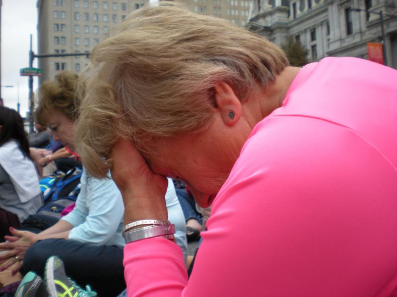 Diane Wheelwright pauses for a moment for prayer
