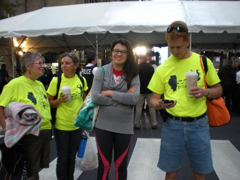 """Mary Jo Roseman,Cathy Bilow, Caitlyn Bilow, Terry Stalsberg on parade route in their """"Francis T-shirts"""""""