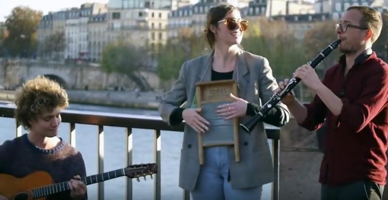 Sweet Megg and the Wayfarers, in a YouTube screen grab, busking on the streets in Paris. Ryan Weisheit is playing the clarinet.