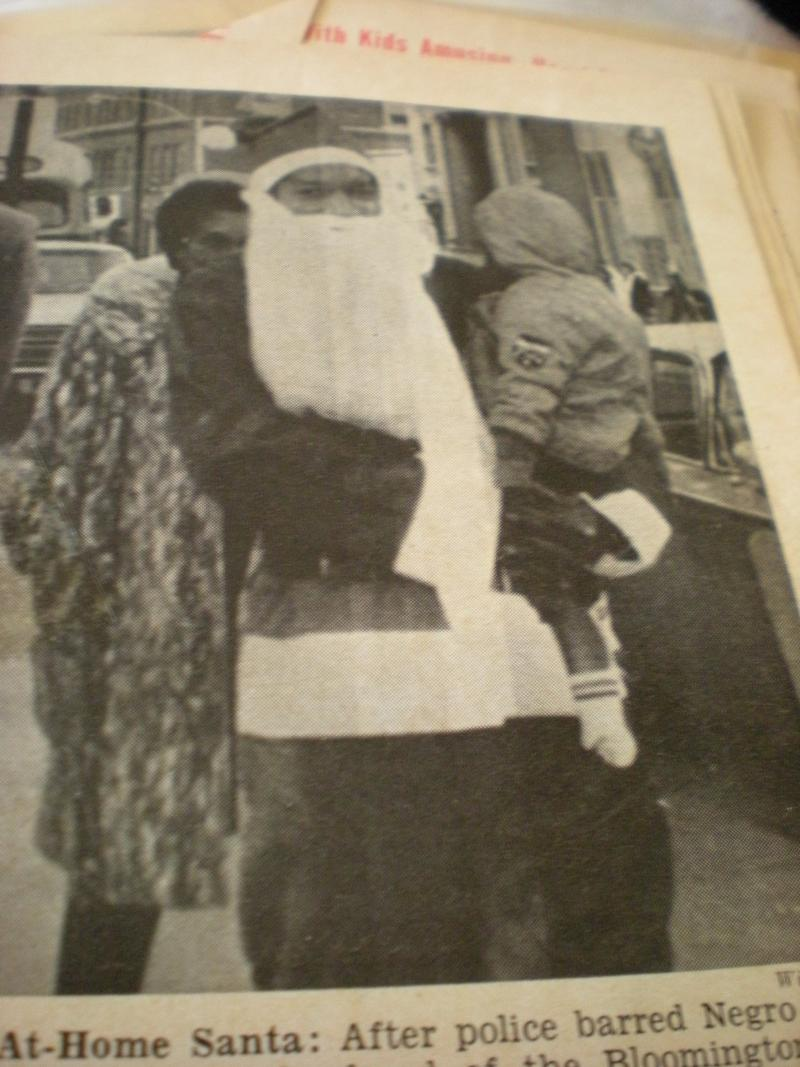 This photograph of Kennedy attempting to portray Santa in the 1966 Bloomington holiday parade appeared in Jet magazine.