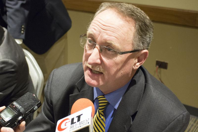 City Manager Mark Peterson speaks with reporters following the Normal Town Council meeting.