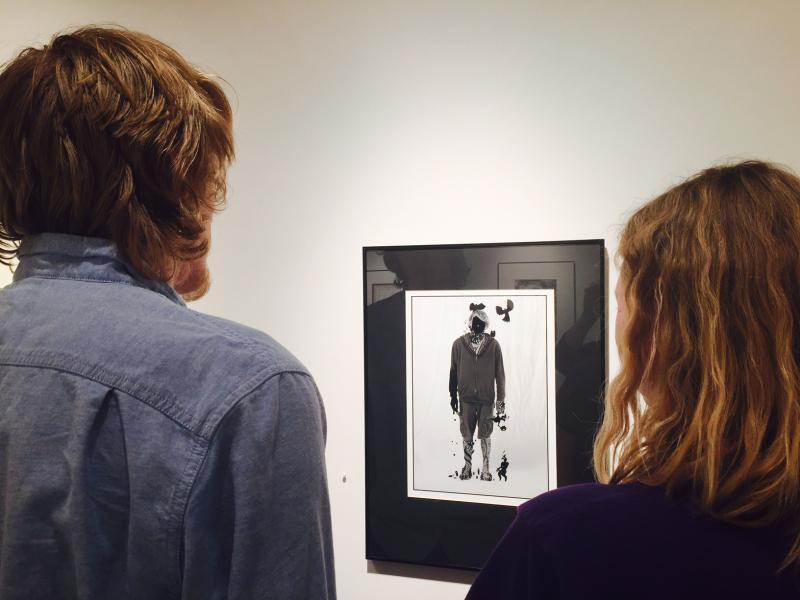 Joseph Anderson views his altered portrait with his art teacher, Monica Estabrook