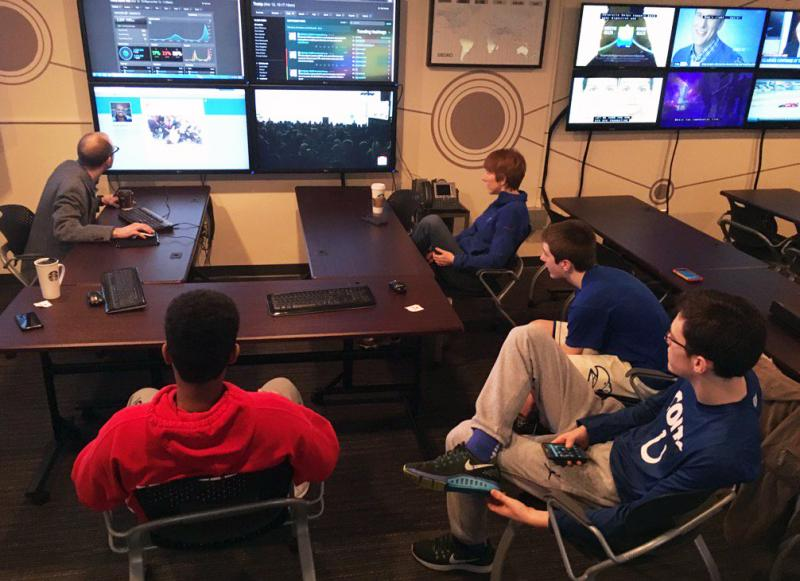 Nate Carpenter, left, with students, monitoring the monitors that make up SMACC.