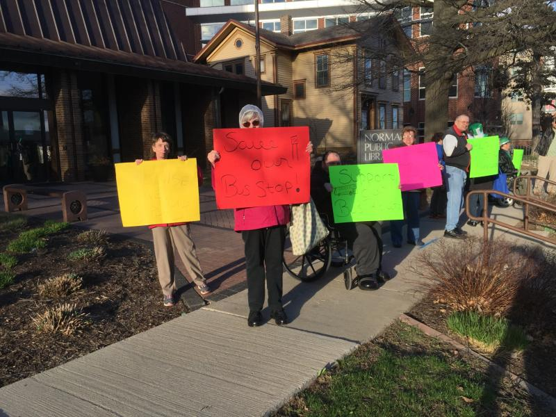 Protesters outside a Connect Transit listening session on proposed changes