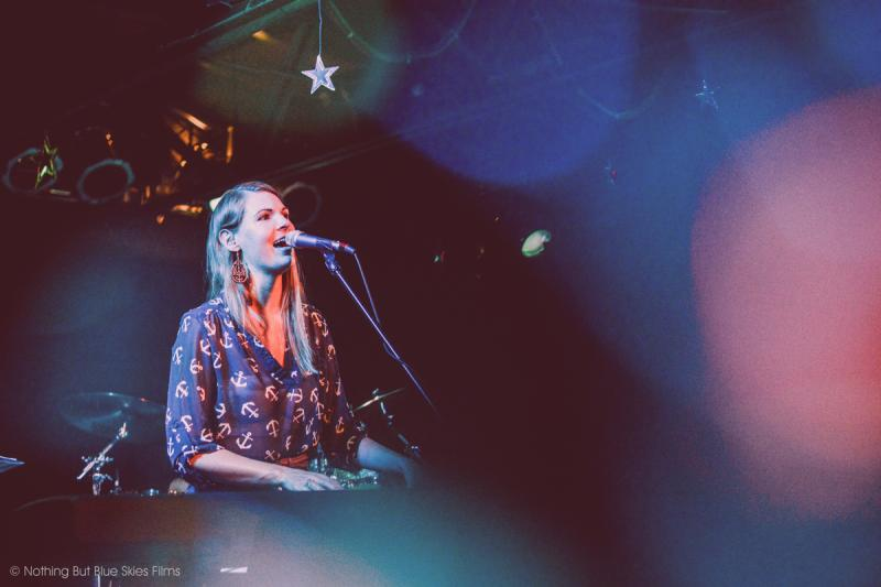 Karen Bridges singing at a live show.