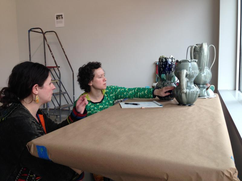Lori Waxman (r) critiques the work of Mariko Brown Harkin.