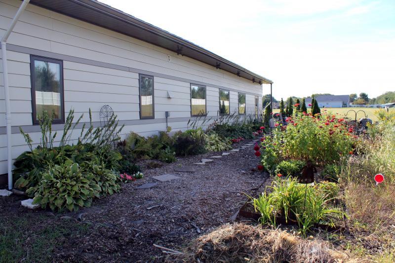 The rear of Equinox House features a shade garden, partial shade garden, and sun garden.