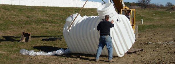 Workers install a cistern that stores collected rainwater.