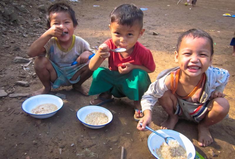 Children eating in Thailand.