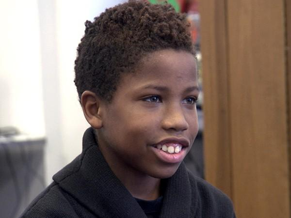 Justen Wallace, 13, fled from a gun battle in his neighborhood.
