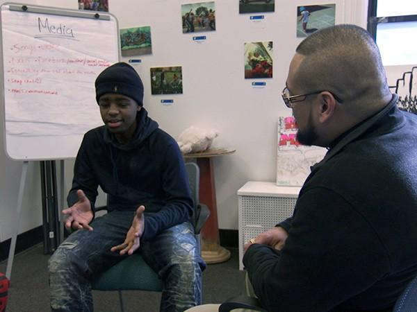 Armir Lightfoot, 17, talks with a combat veteran about trauma from gun violence at a Chicago YMCA facility.