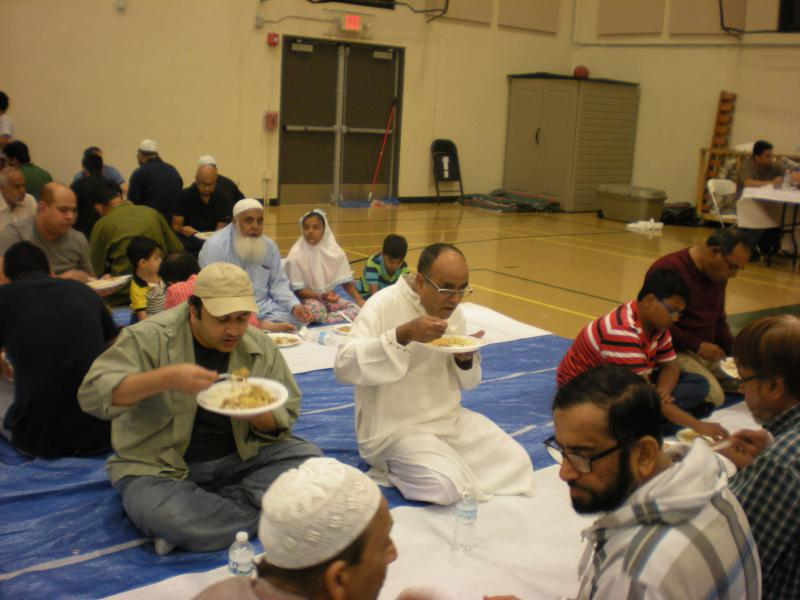 At the Islamic Center of Naperville, members break a 17-hour fast  for Ramadan in a communal meal.