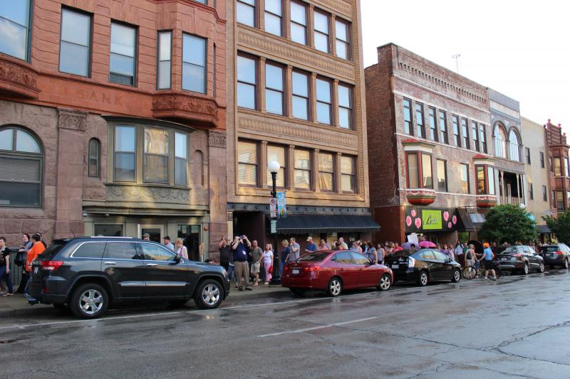 A group of people marched from The Bistro along Main Street in Bloomington.