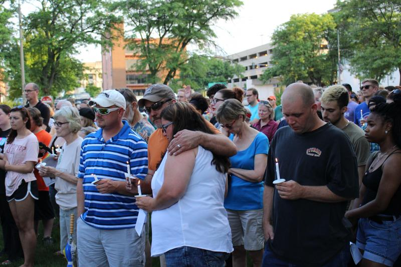 People bowed their heads during the name reading and moment of silence.