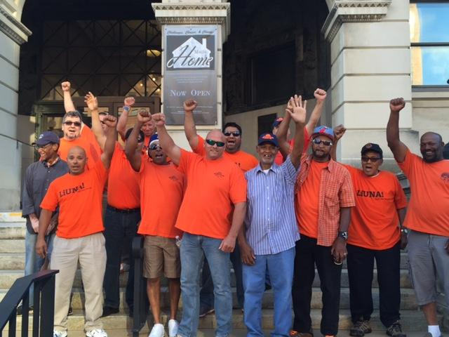 Laborers union members on the steps of the old courthouse