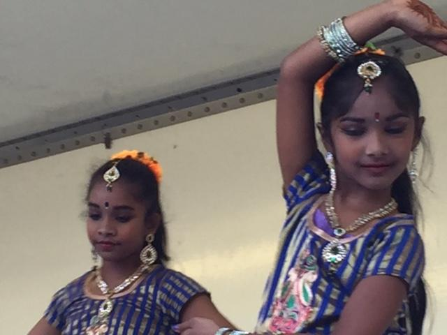 Two girls dancing in traditional Indian attire