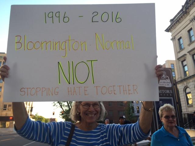 Anne Libert with sign for rally