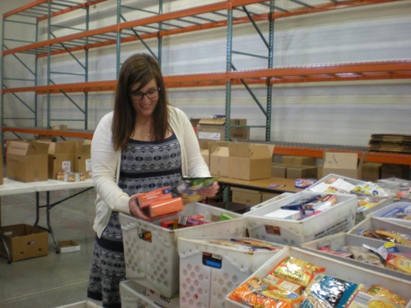Angie Fulton, development director at the Salvation Army, sorts through food donations for the agency's food bank.