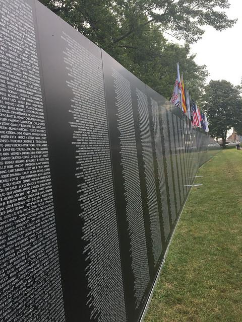 A linear view of the American Veterans Traveling Tribute Wall at Evergreen Cemetery in Bloomington.