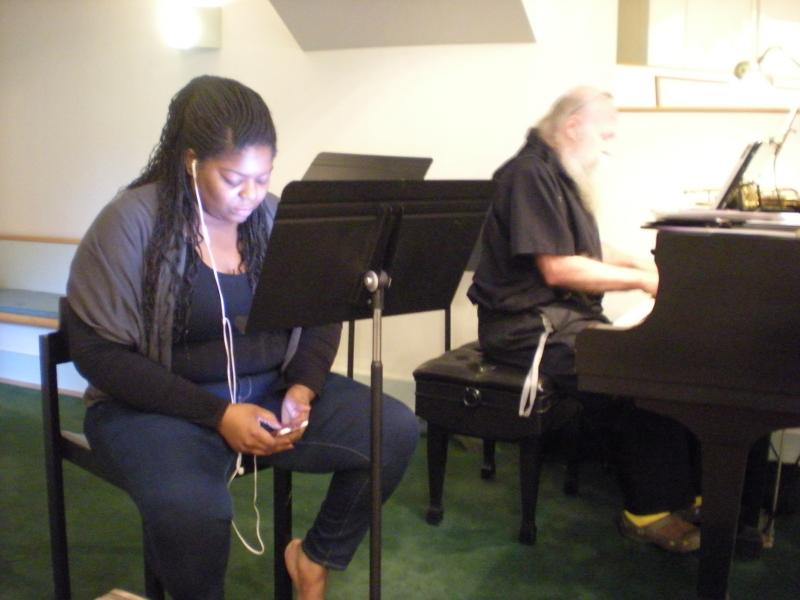 "Vocalist Jamika Russell practices Ray Charles' ""Light Out Of Darkness"" before Sunday evening Jazz Vespers service."