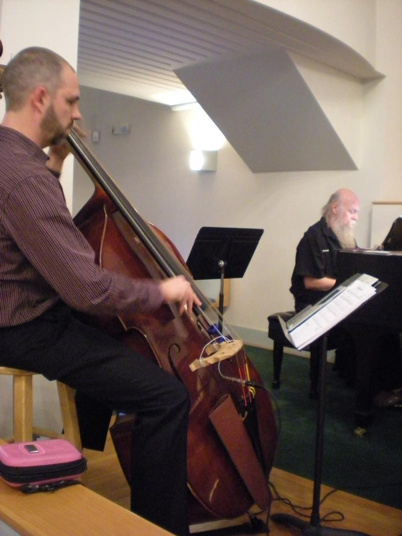 Andy Crawford plays bass at the Sunday night jazz service.