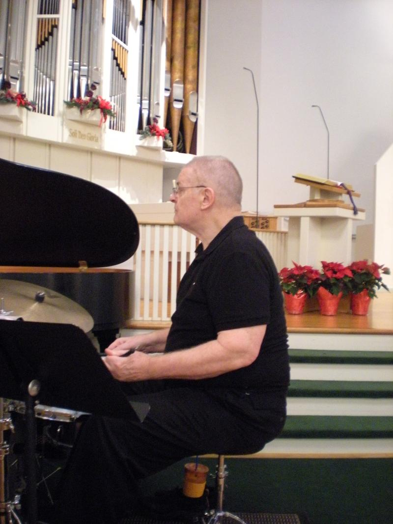 Bob McEntyre, a medical doctor, drives in from Bloomington to play drums in the Jazz Vespers combo.
